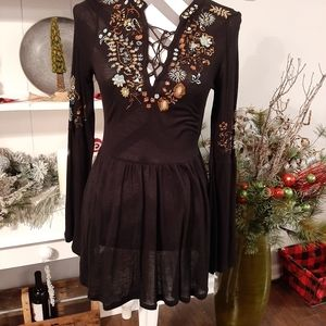 Shirt with embroidered chest and sleeves and back